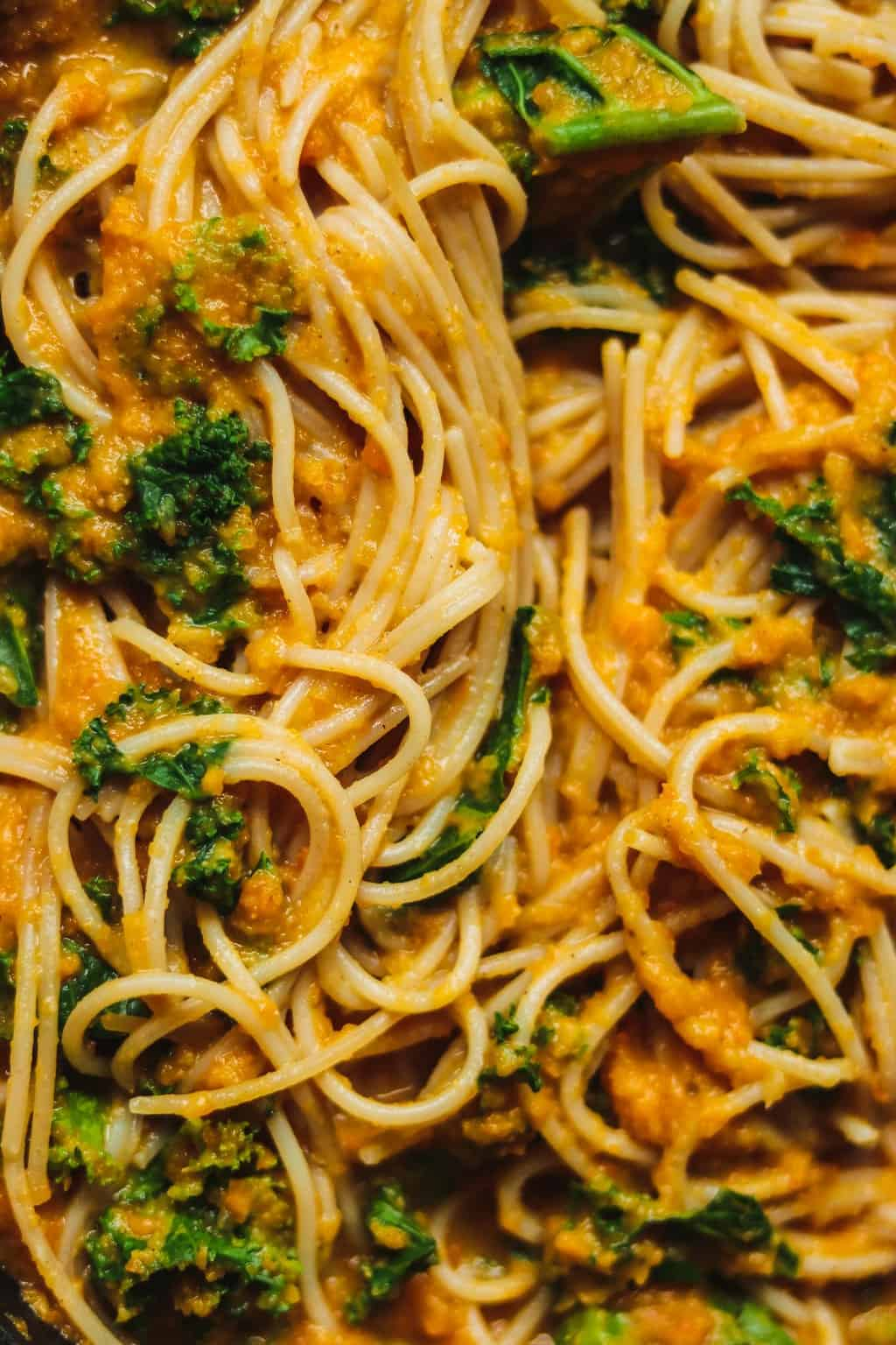 Closeup of spaghetti with pumpkin and kale