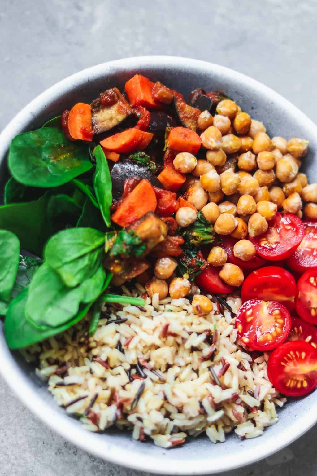 Closeup of bowl with chickpeas rice and vegetables