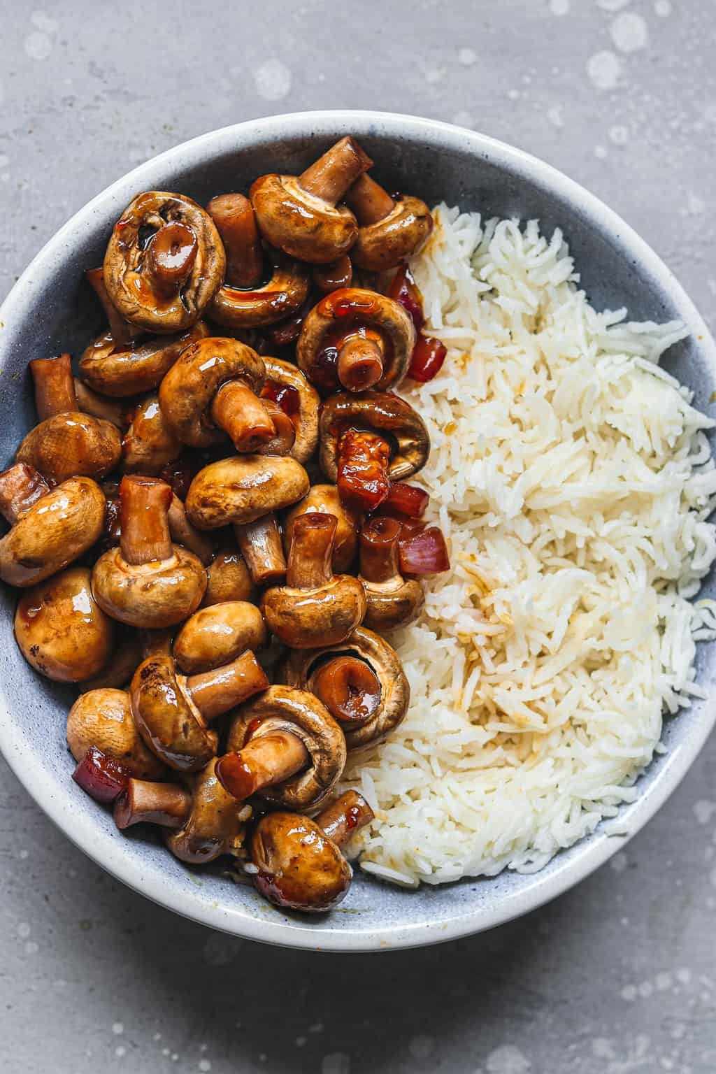 Mushrooms and rice in a blue bowl