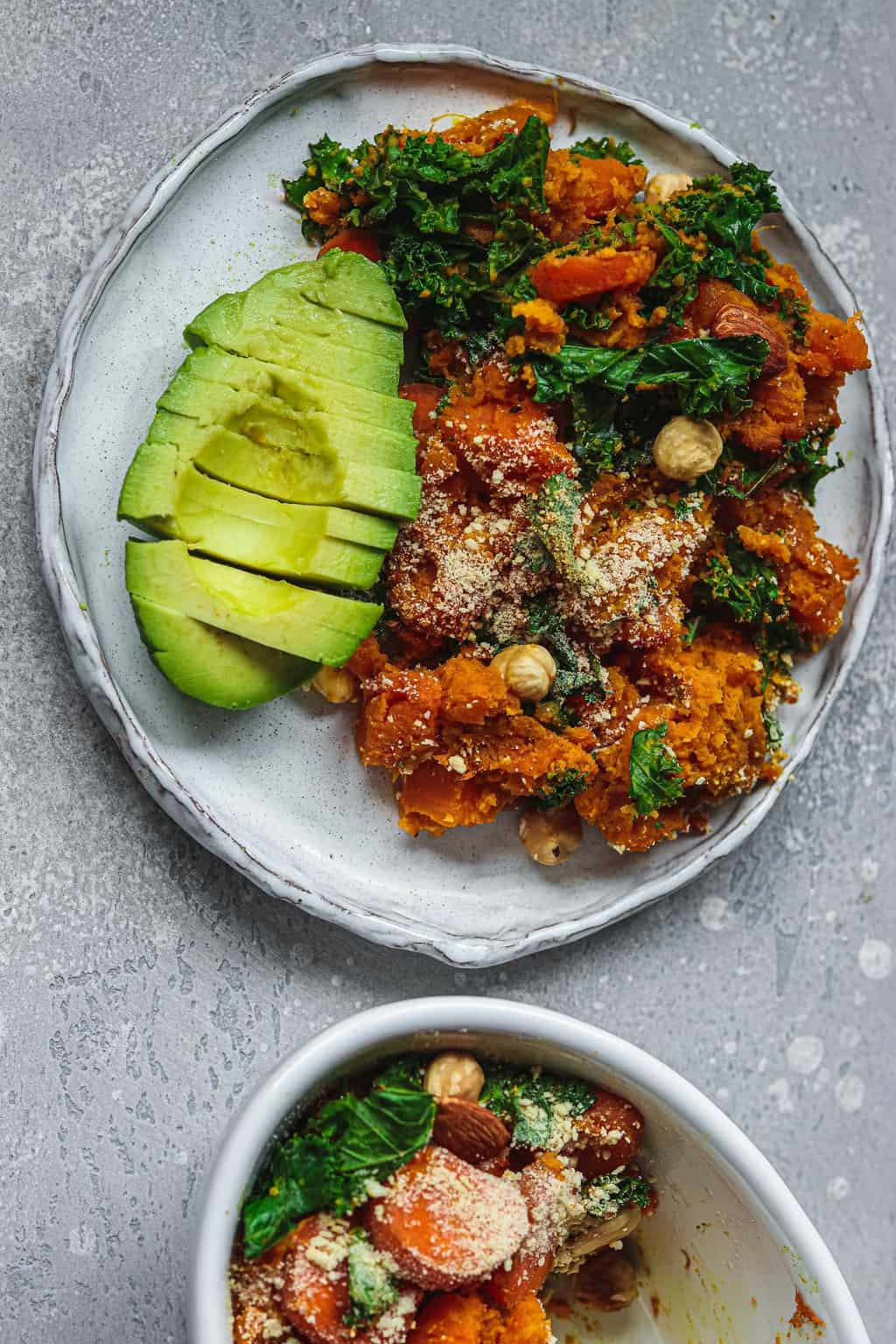 Casserole on a white plate with avocado