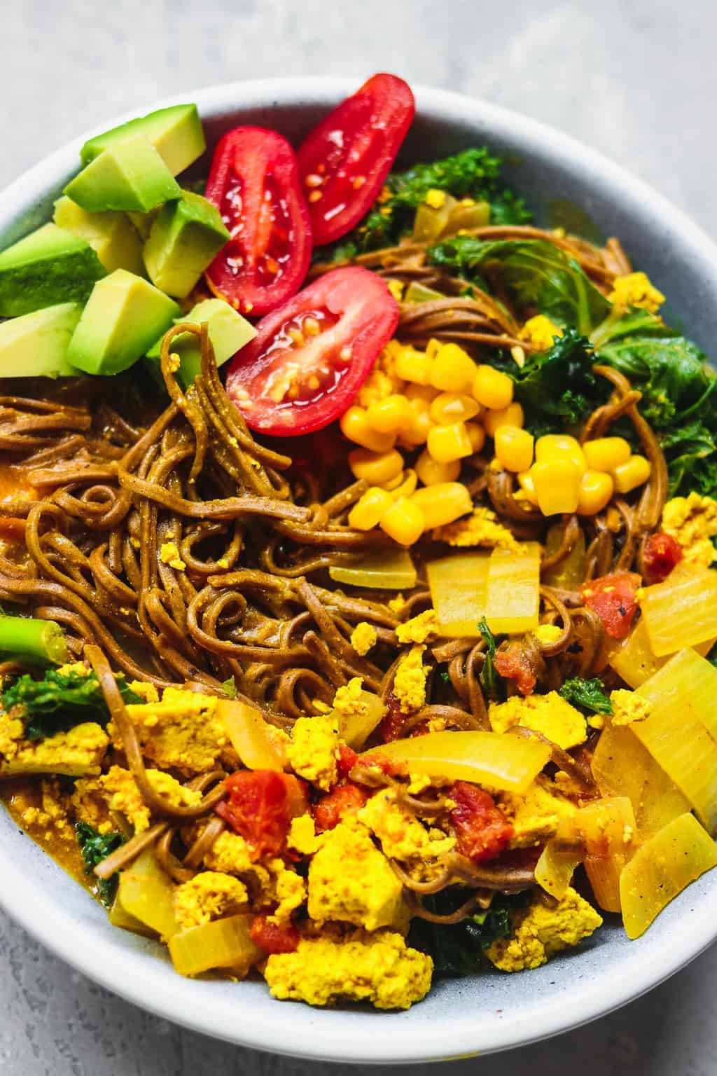 Blue bowl with noodles and tofu