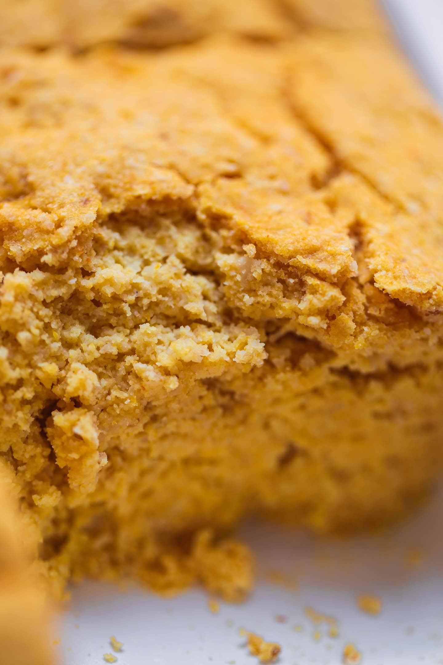 Closeup of vegan cornbread in a baking dish