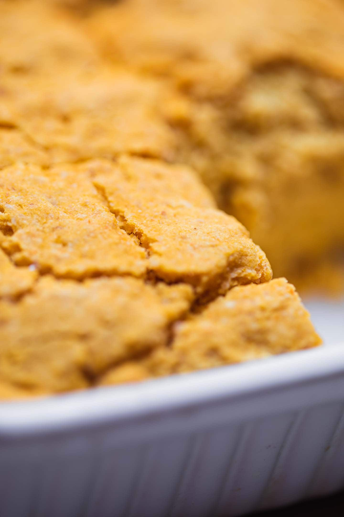 Closeup of cornbread in a baking dish