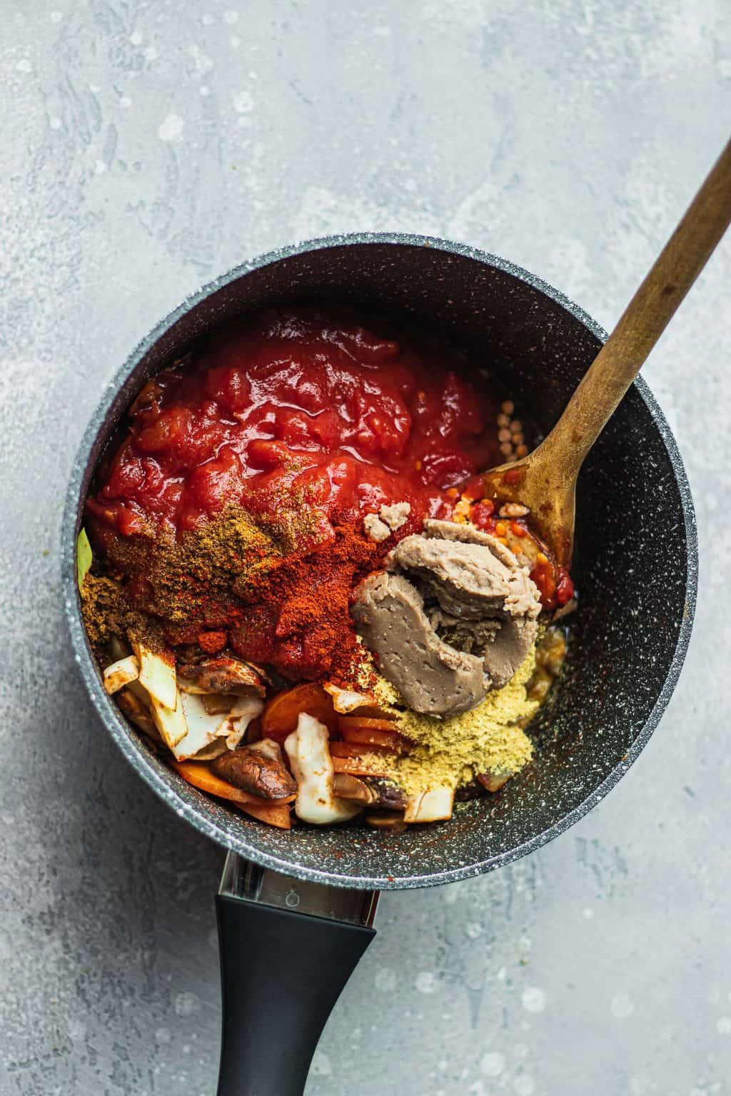Lentil bolognese ingredients in a saucepan
