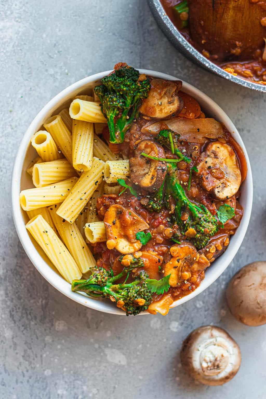 Bowl of vegan lentil pasta sauce with broccoli