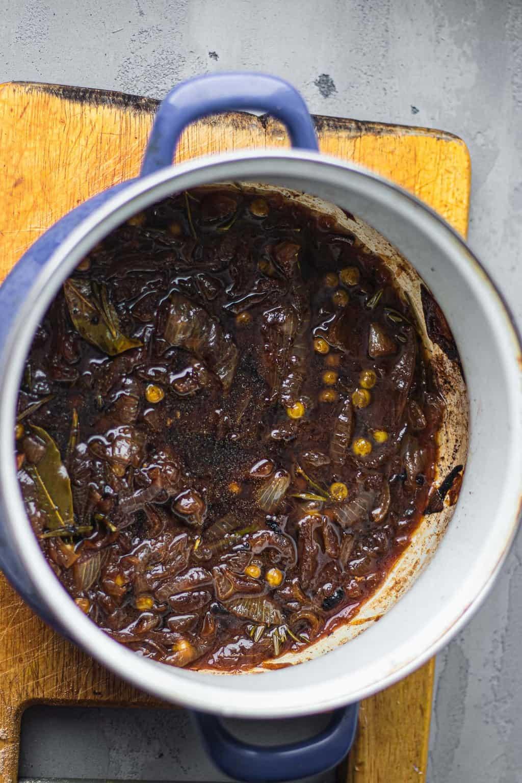 Vegan French onion soup in a saucepan
