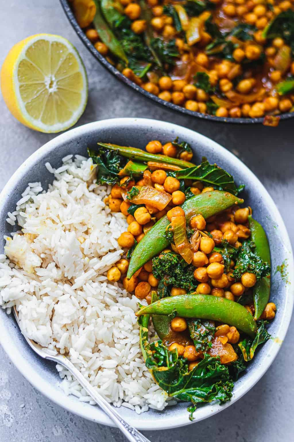 Blue bowl with vegan curry and white rice