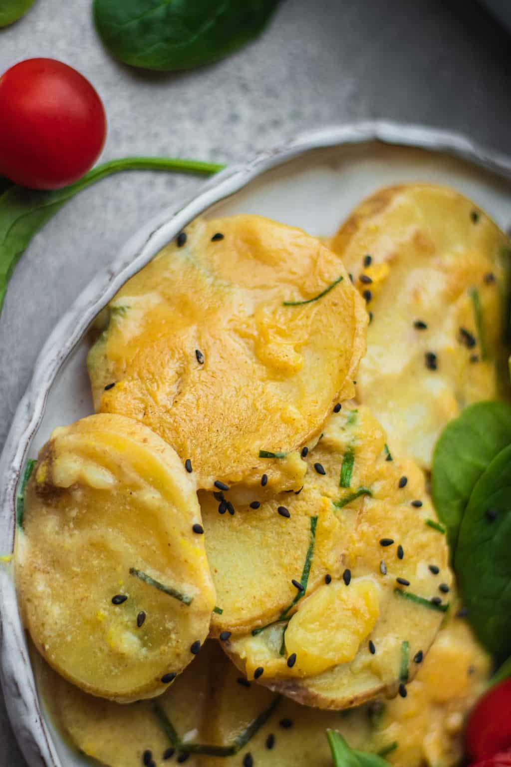 Closeup of potatoes with cheesy sauce