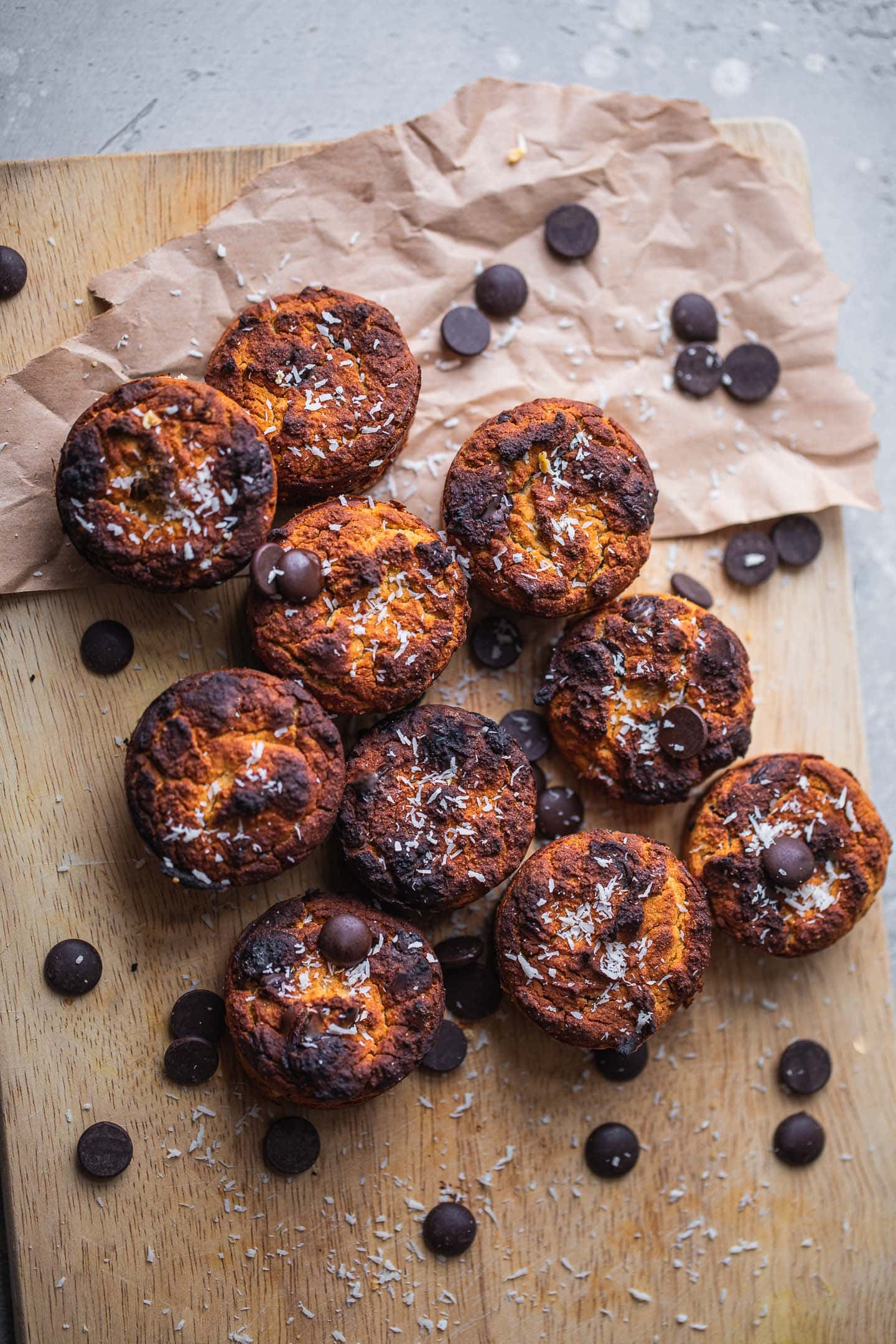 Dairy-free muffins with chocolate chips on a wooden board