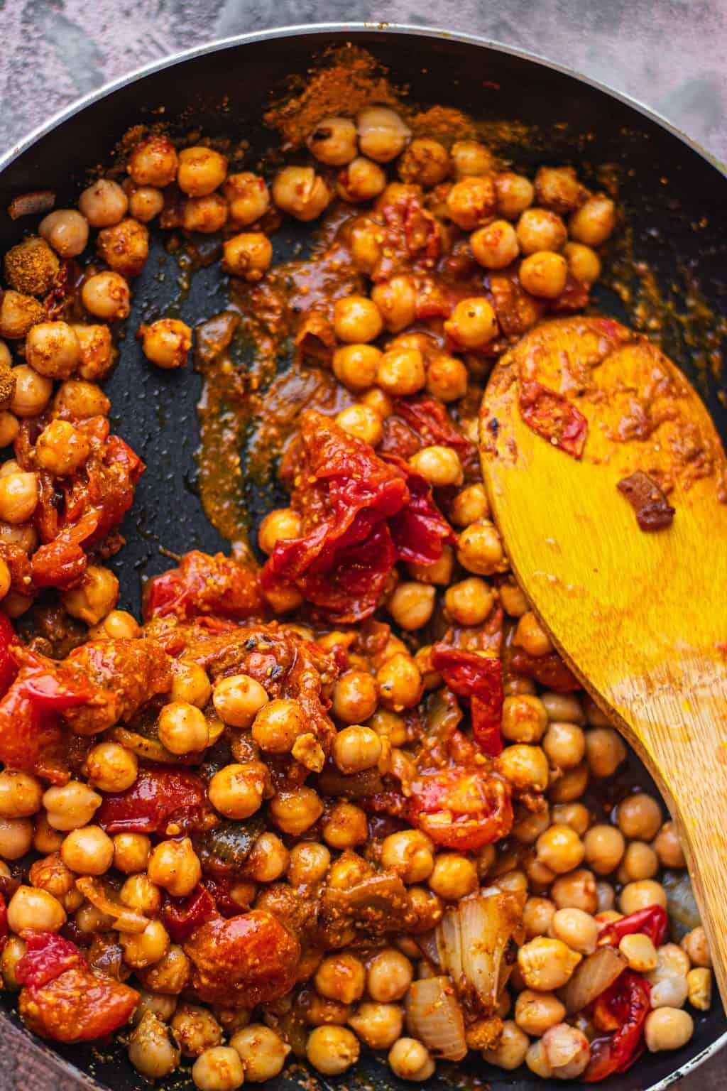 Curried chickpeas in a frying pan