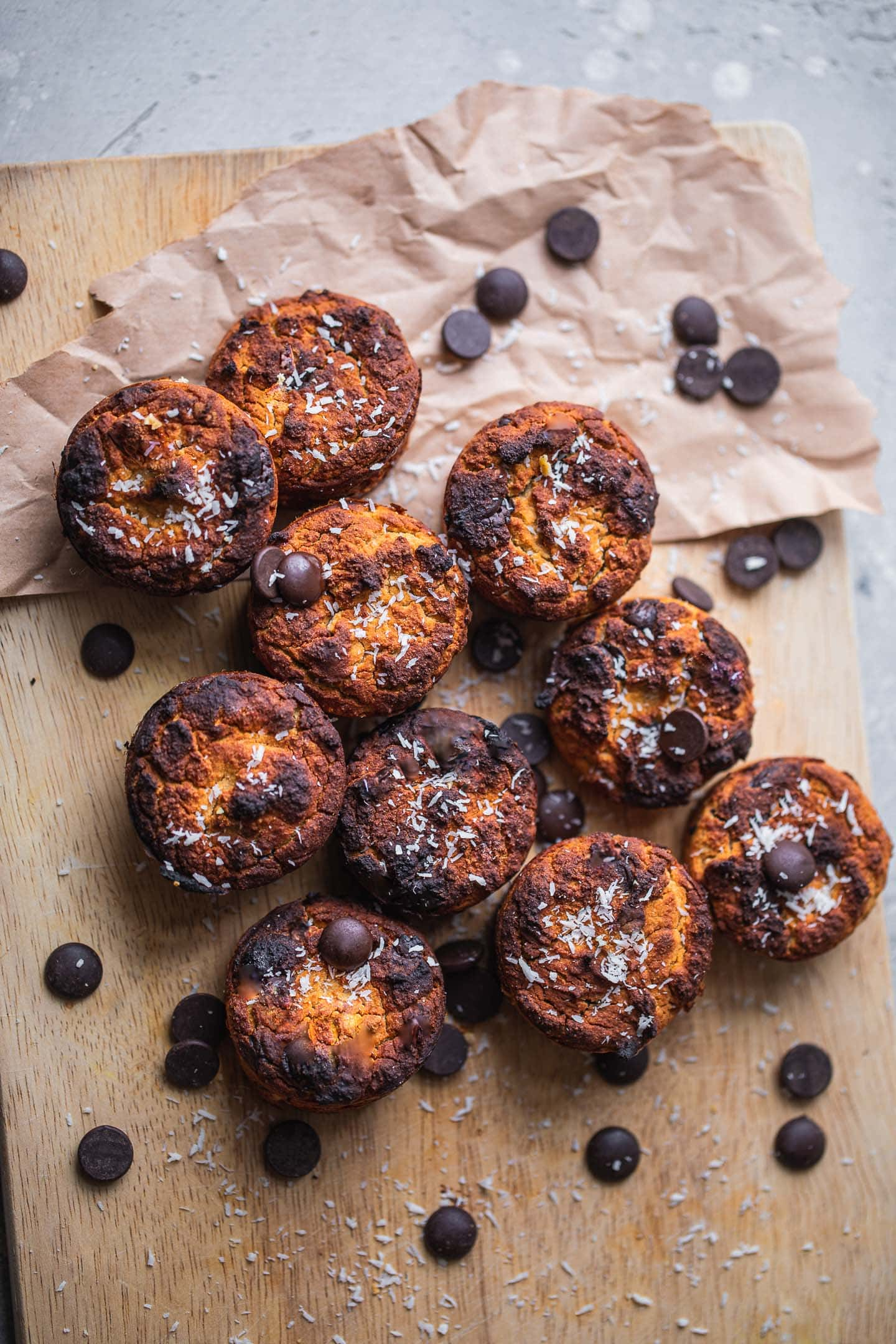 Mini vegan muffins with chocolate chips on a wooden board