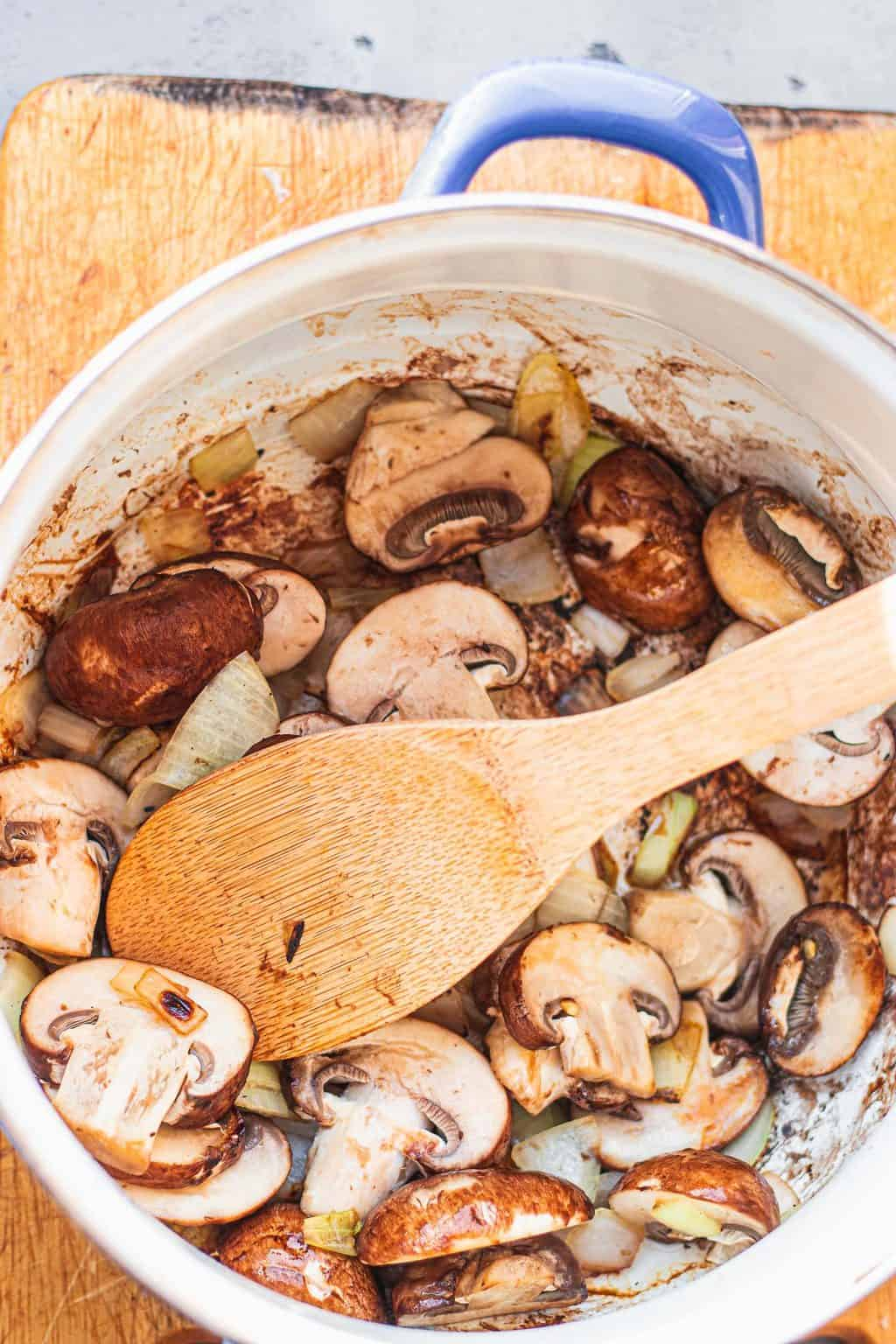 Mushrooms and onions in a sauce pan