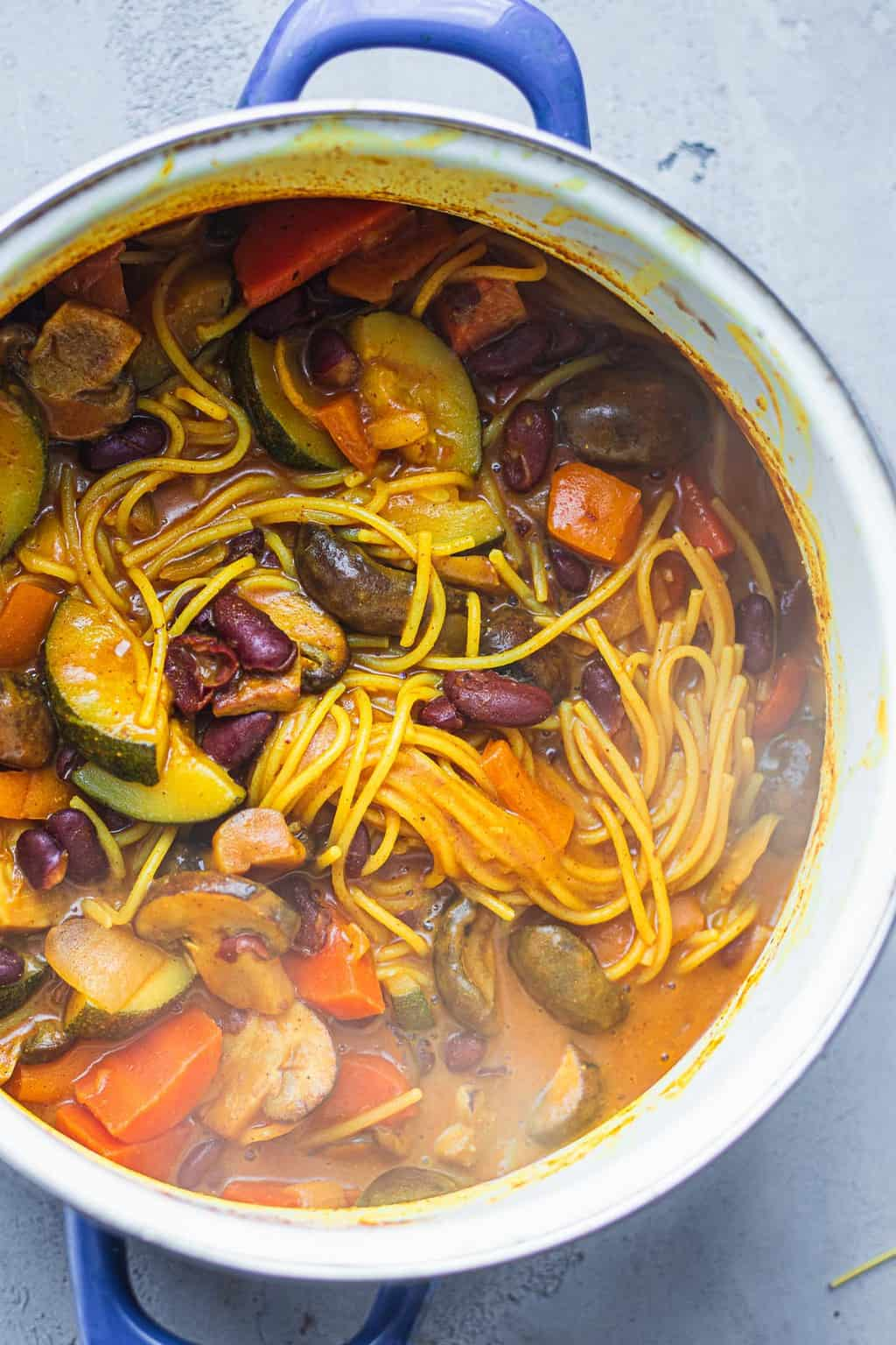 Spaghetti with vegetables in a saucepan