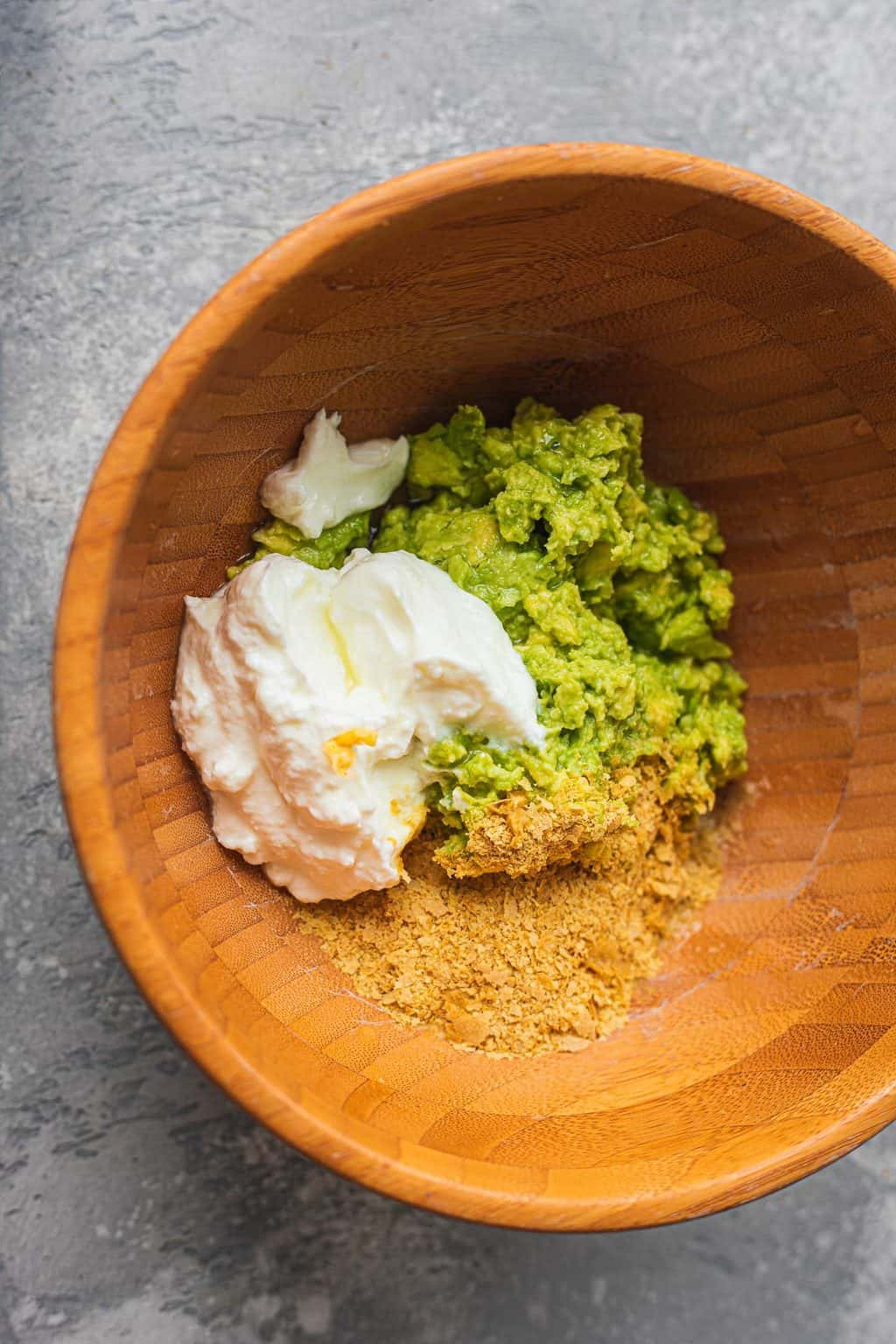 Avocado and soy yoghurt in a mixing bowl