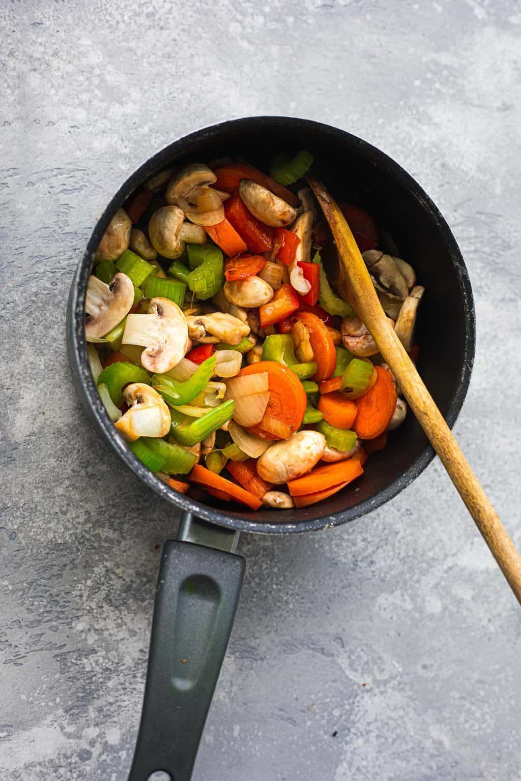 Mushrooms and vegetables in a saucepan
