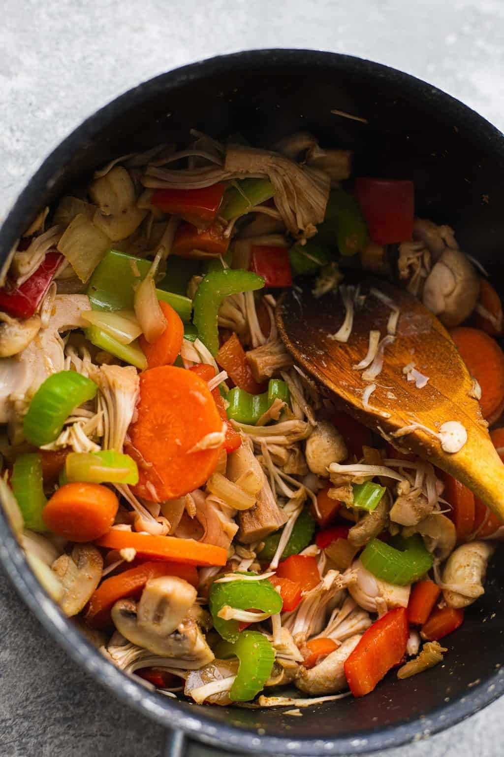 Vegetables and jackfruit in a saucepan
