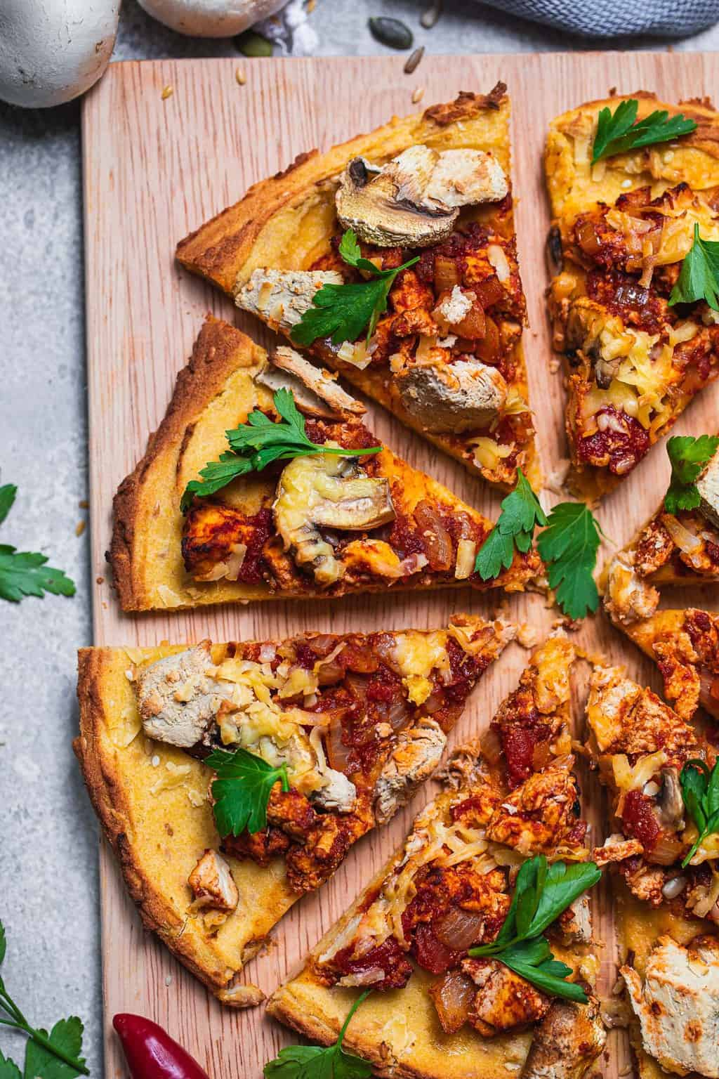 Gluten-free vegan pizza with mushrooms and tofu
