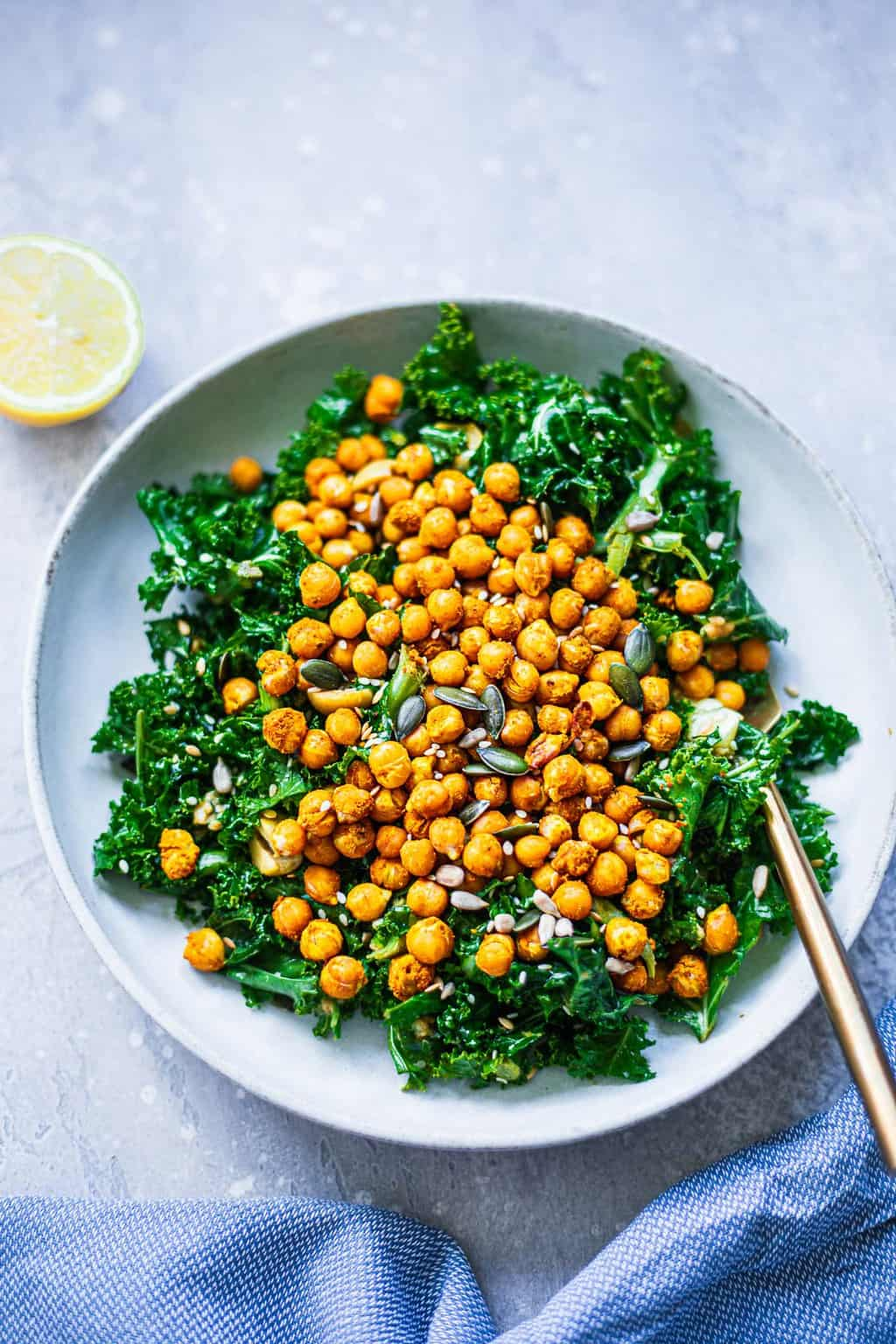 Kale and chickpeas in a white bowl