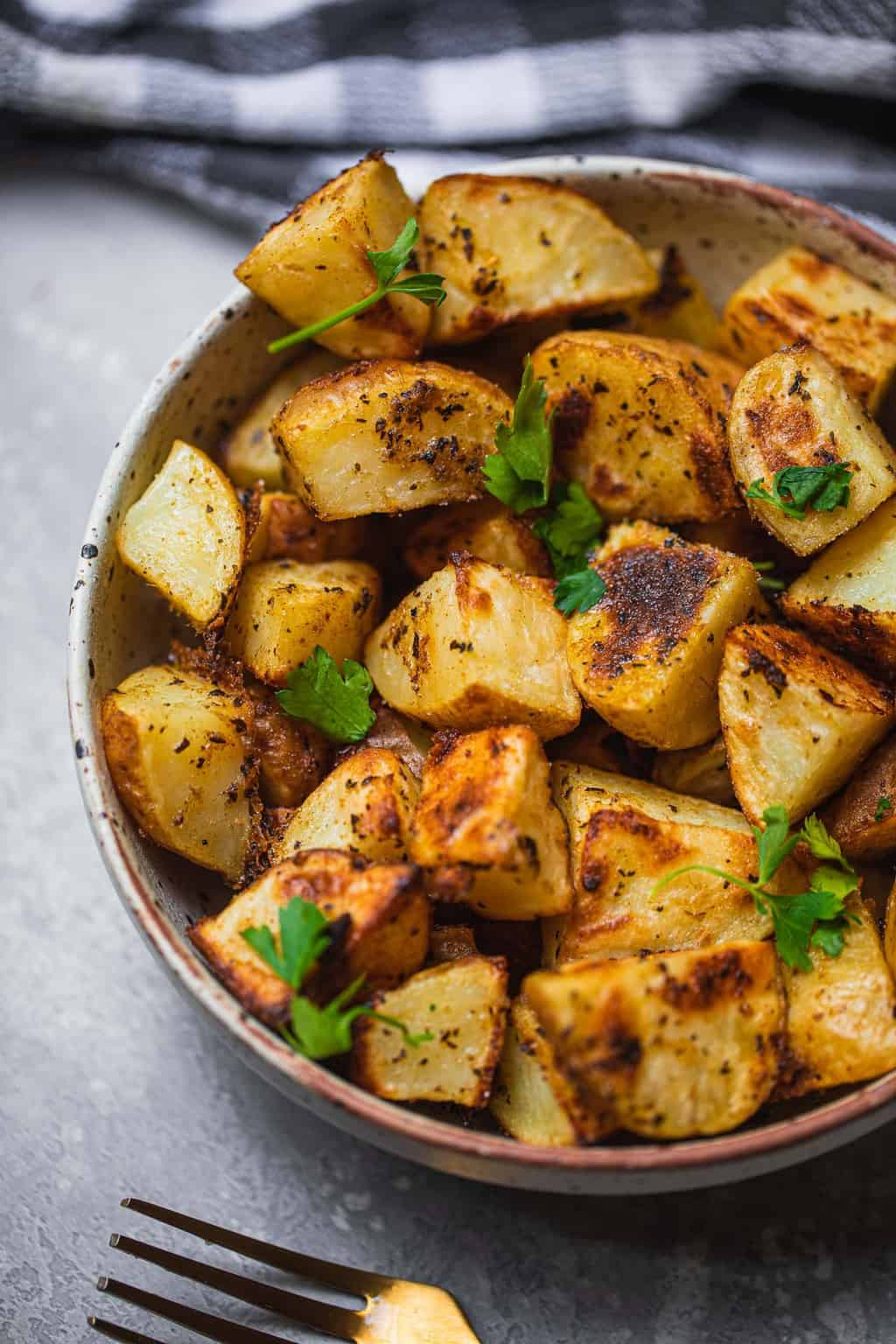 Crispy potatoes in a white bowl