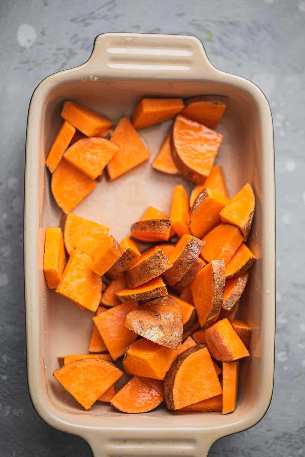 Sweet potato slices in a baking dish