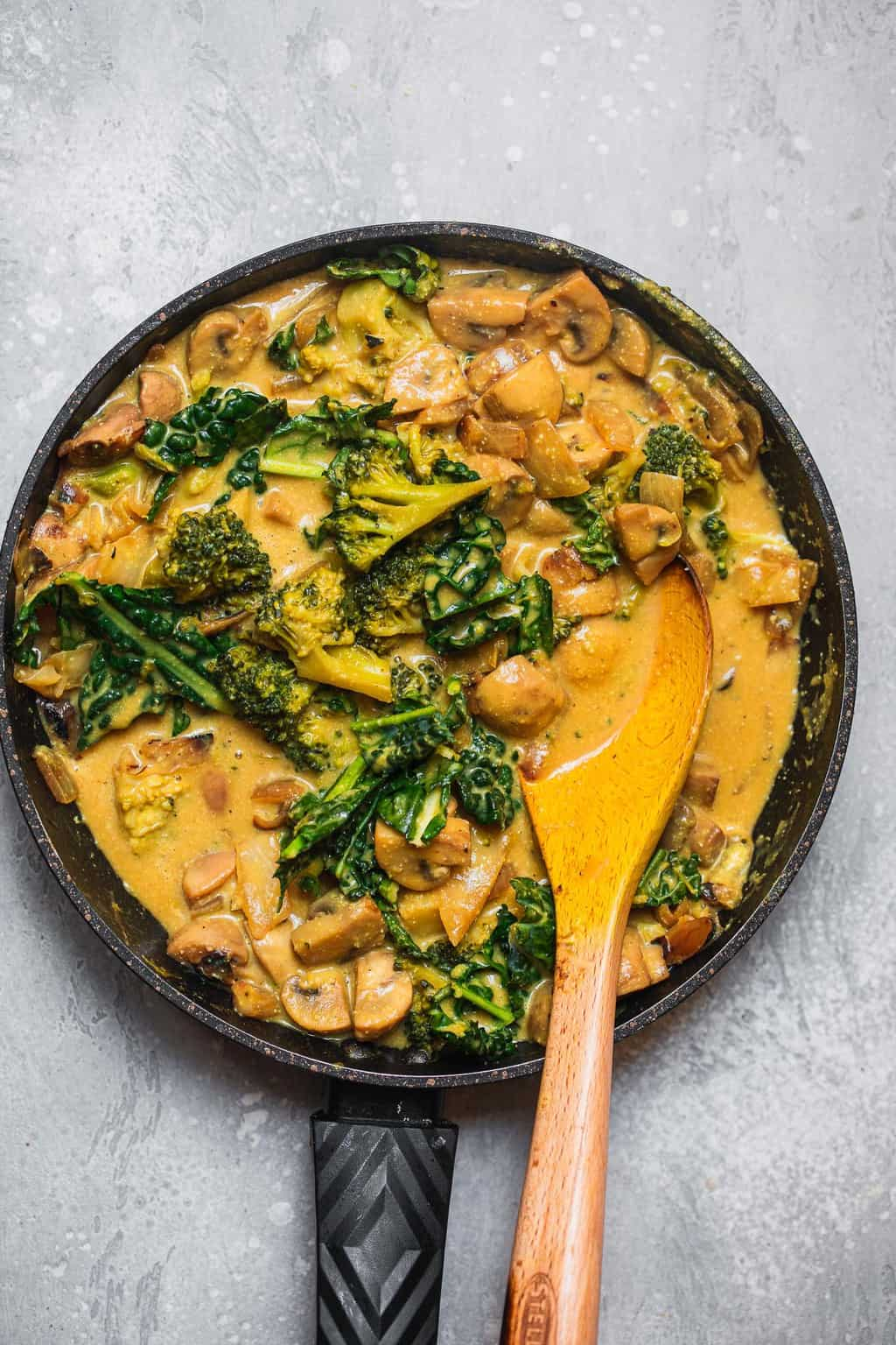 Vegan gluten-free broccoli cheese soup in a saucepan