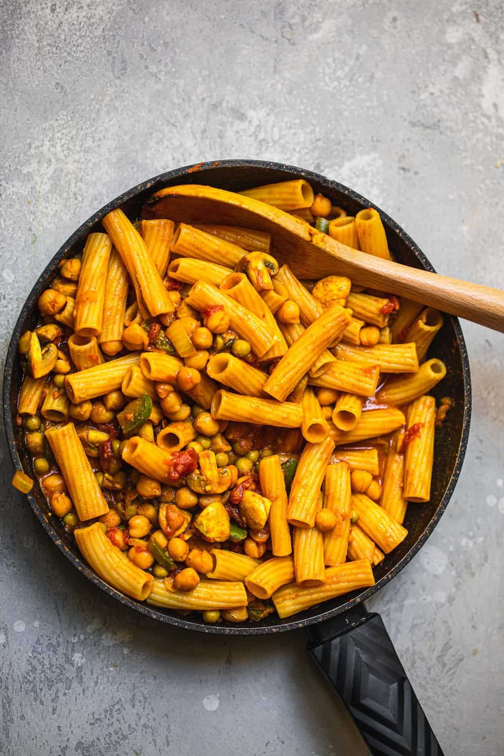 Pasta with chickpeas and mushrooms in a frying pan