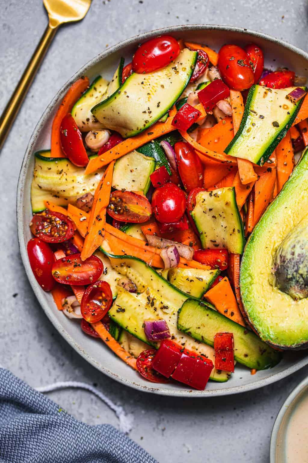 Salad with zucchini sweet potato and tomatoes