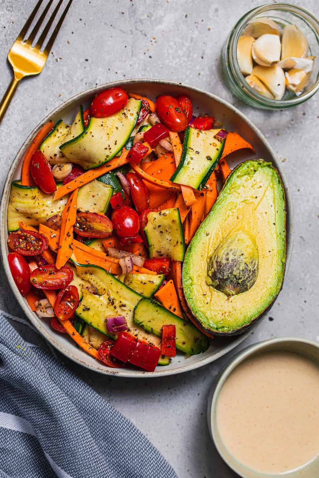 Bowl of salad with zucchini and sweet potato