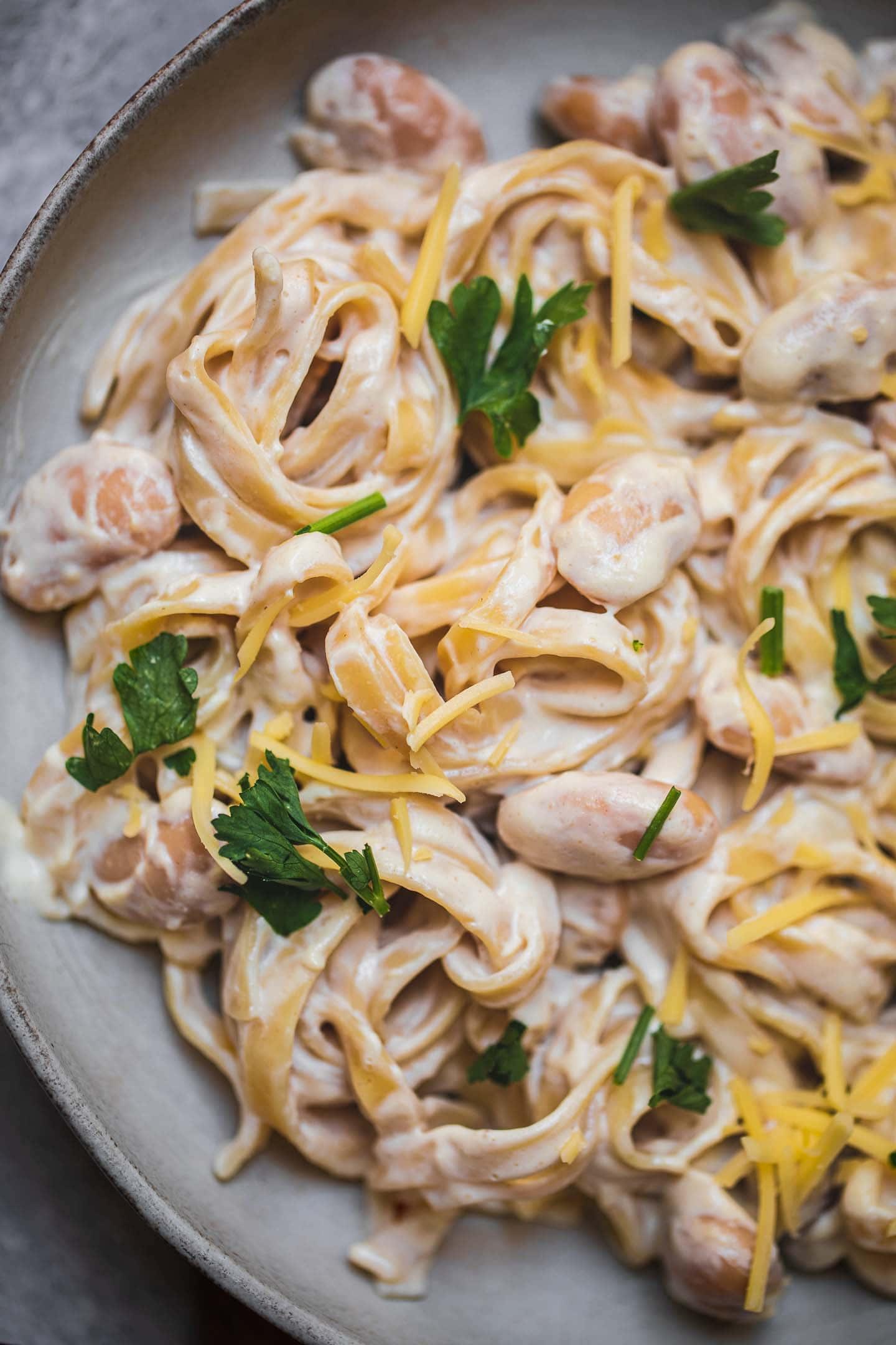 Plate of garlic pasta with vegan cheese