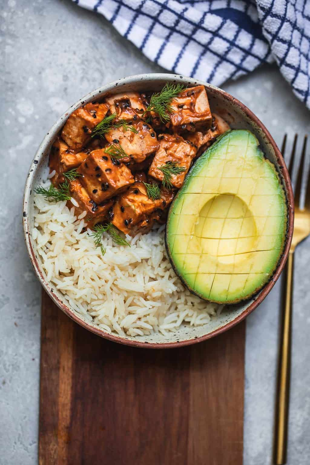 Bowl with peanut tofu rice and avocado
