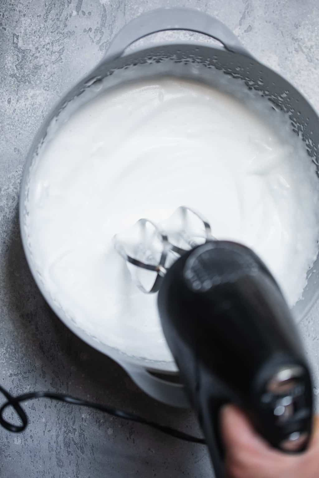 Whipped aquafaba in a mixing bowl