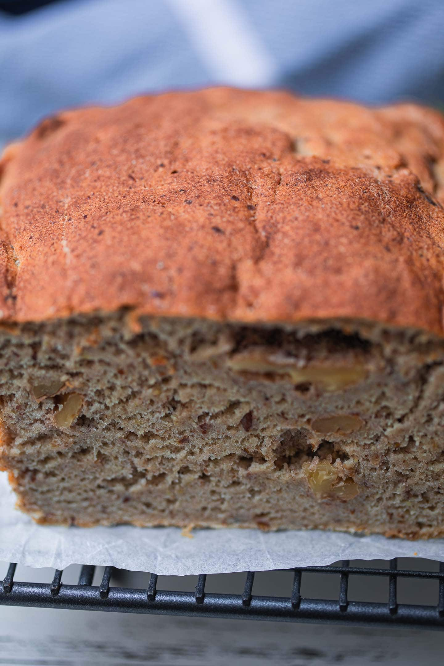 Closeup of a vegan bread loaf on a cooling rack