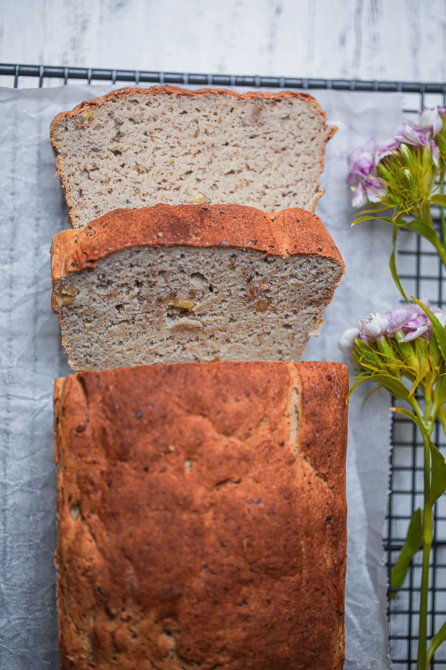 Sliced gluten-free vegan bread with walnuts