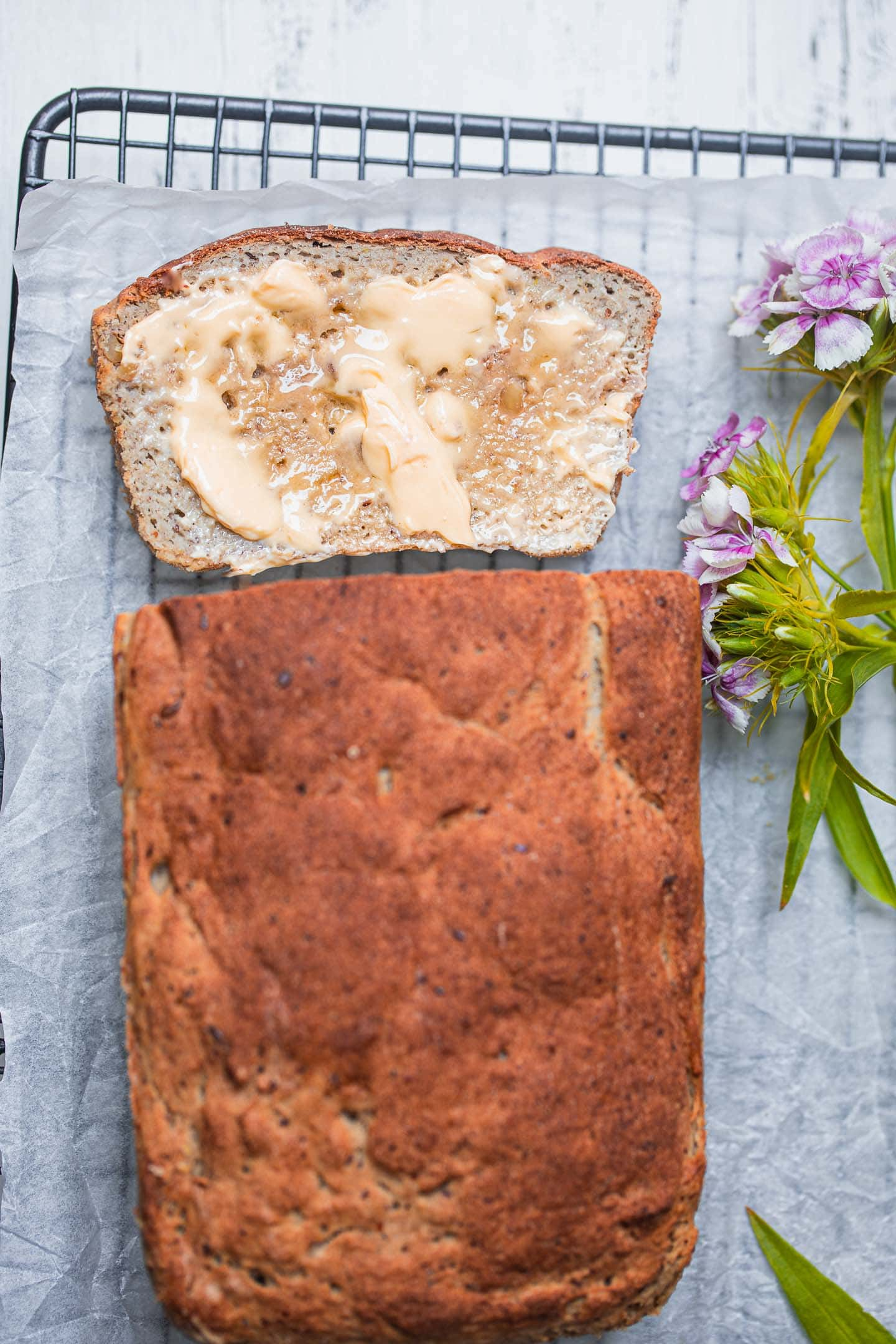 Sliced vegan bread loaf with vegan butter