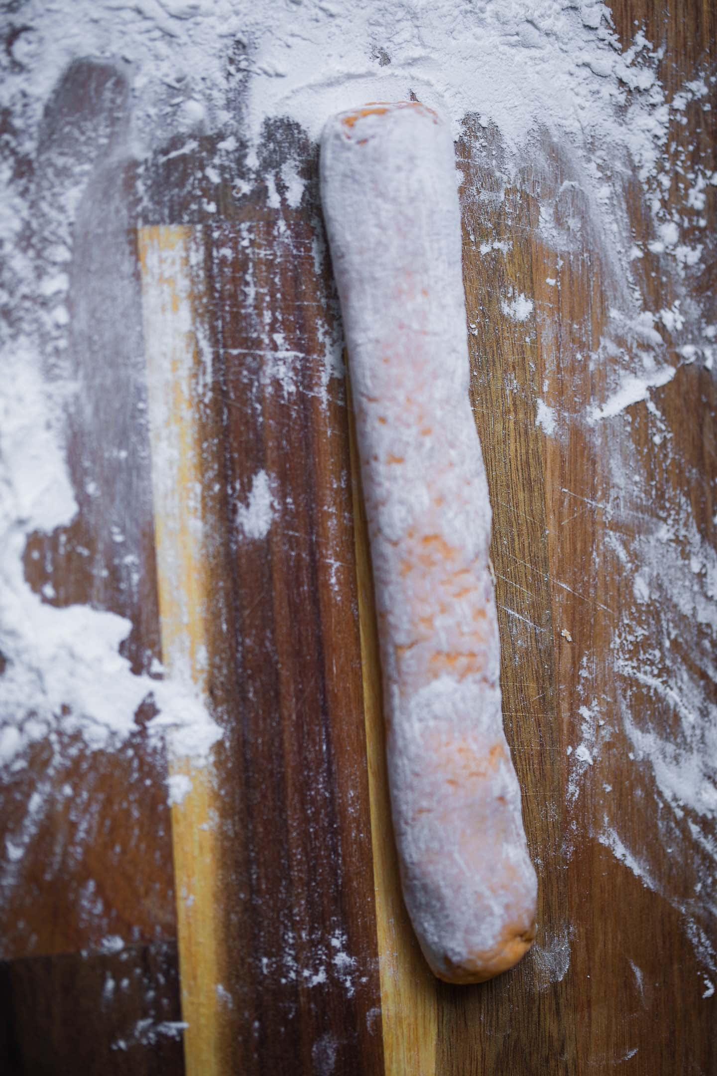Sweet potato gnocchi dough on a chopping board