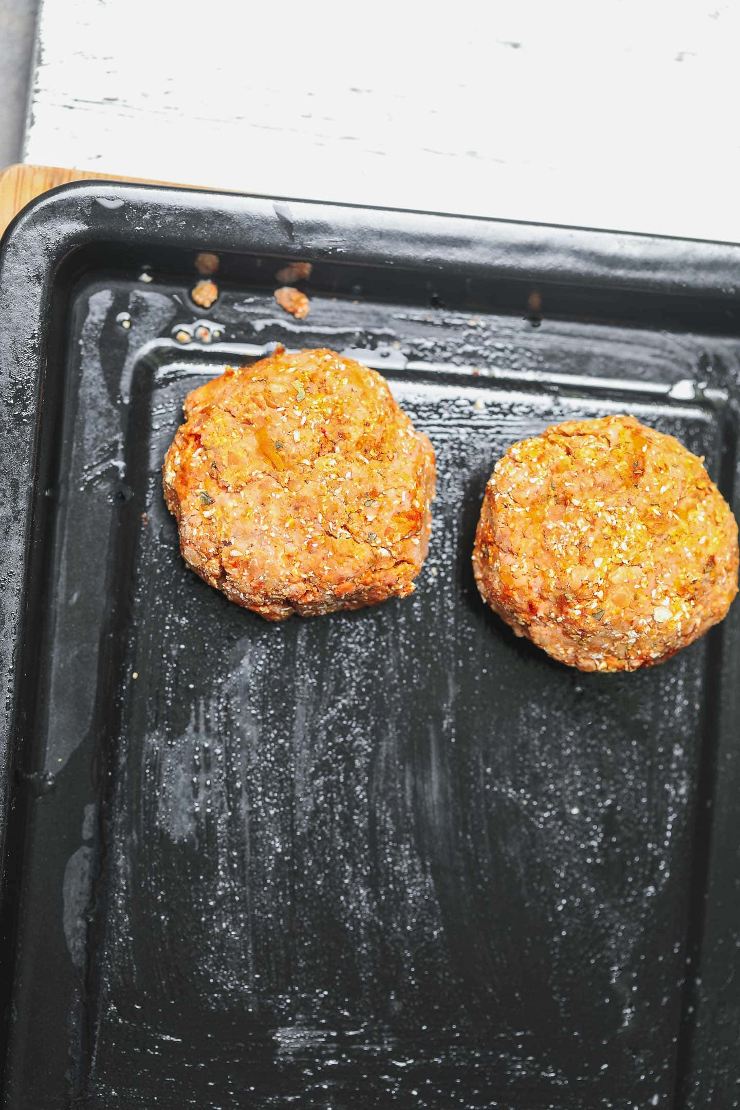 Veggie burgers on a baking tray before cooking