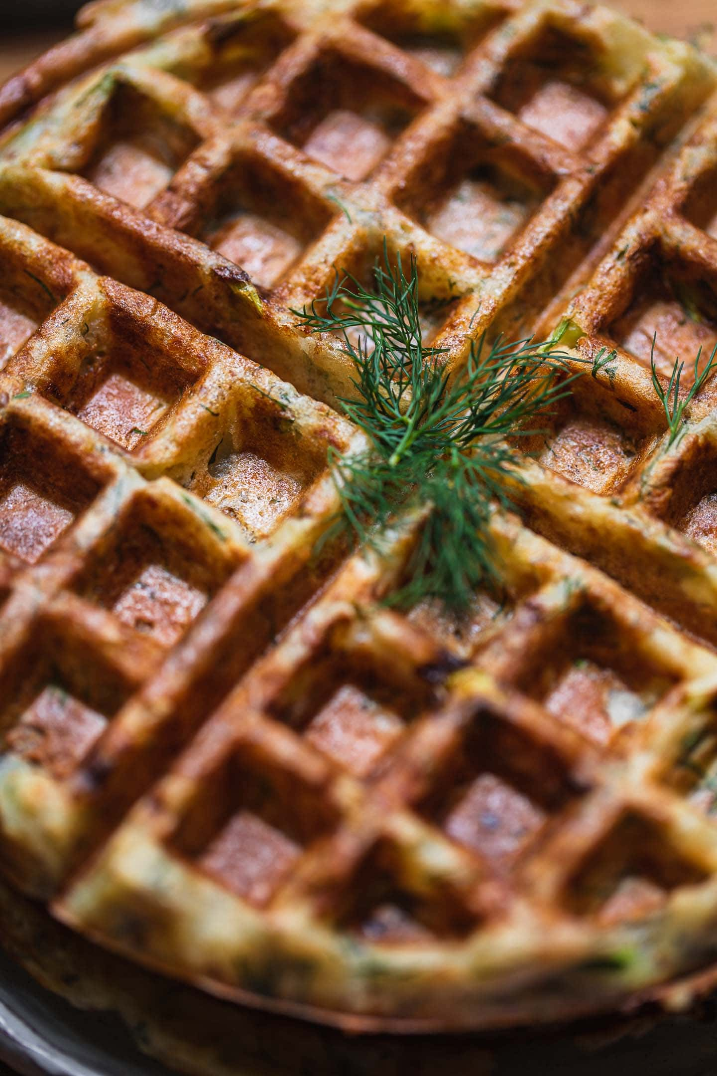Closeup of potato waffles with dill on top
