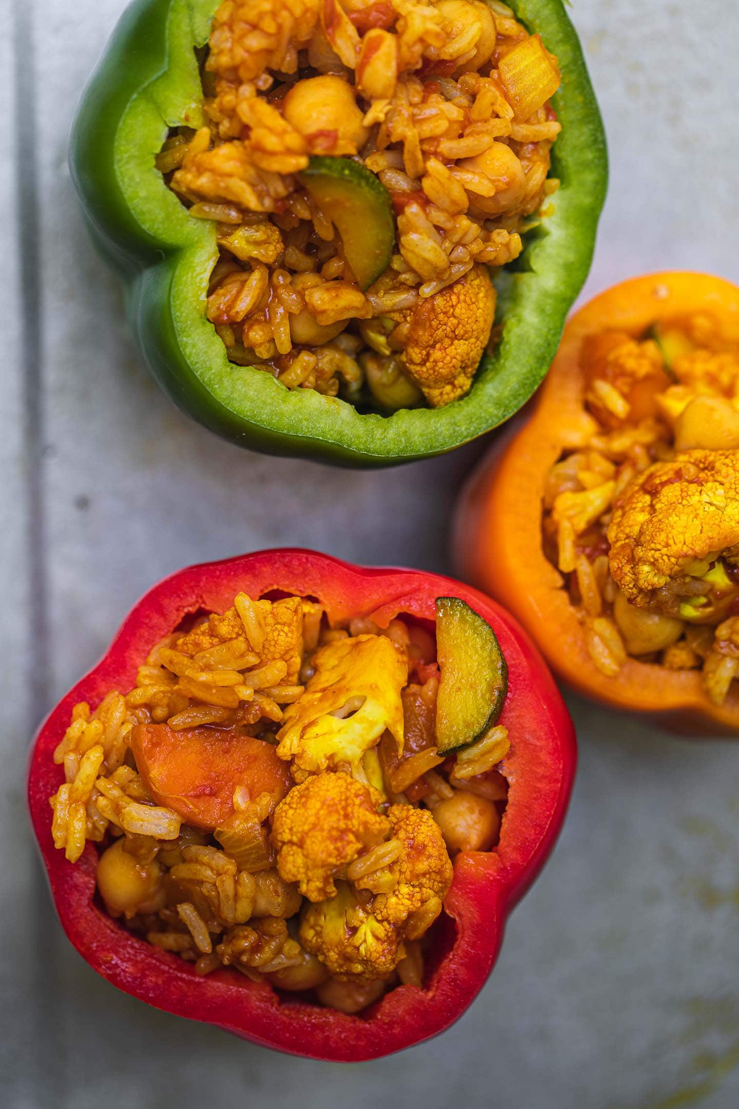 Stuffed peppers with rice chickpeas and cauliflower before baking