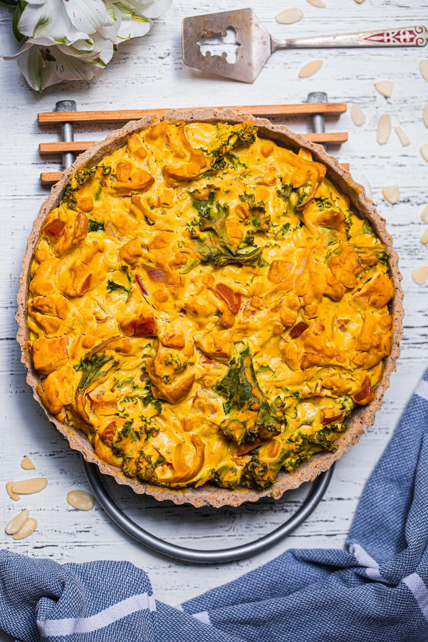 Quiche with kale on a cooling rack