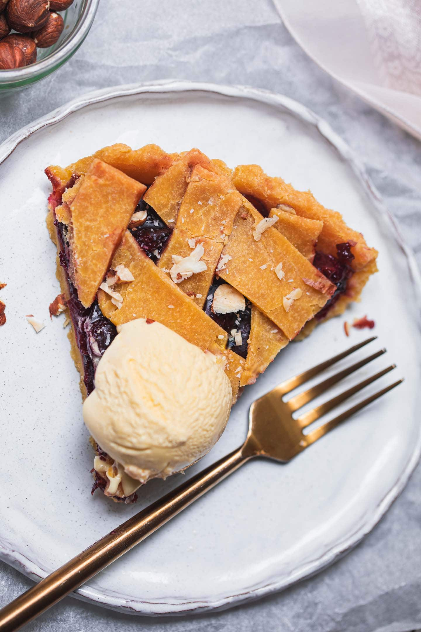 Vegan cherry pie with dairy-free ice cream on top