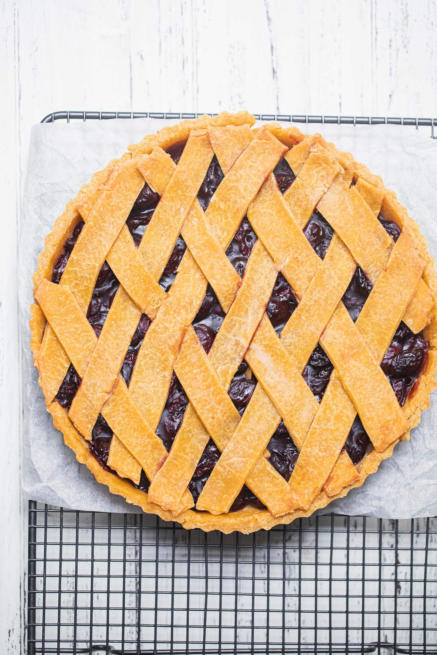 Gluten-free vegan cherry pie on a cooling rack