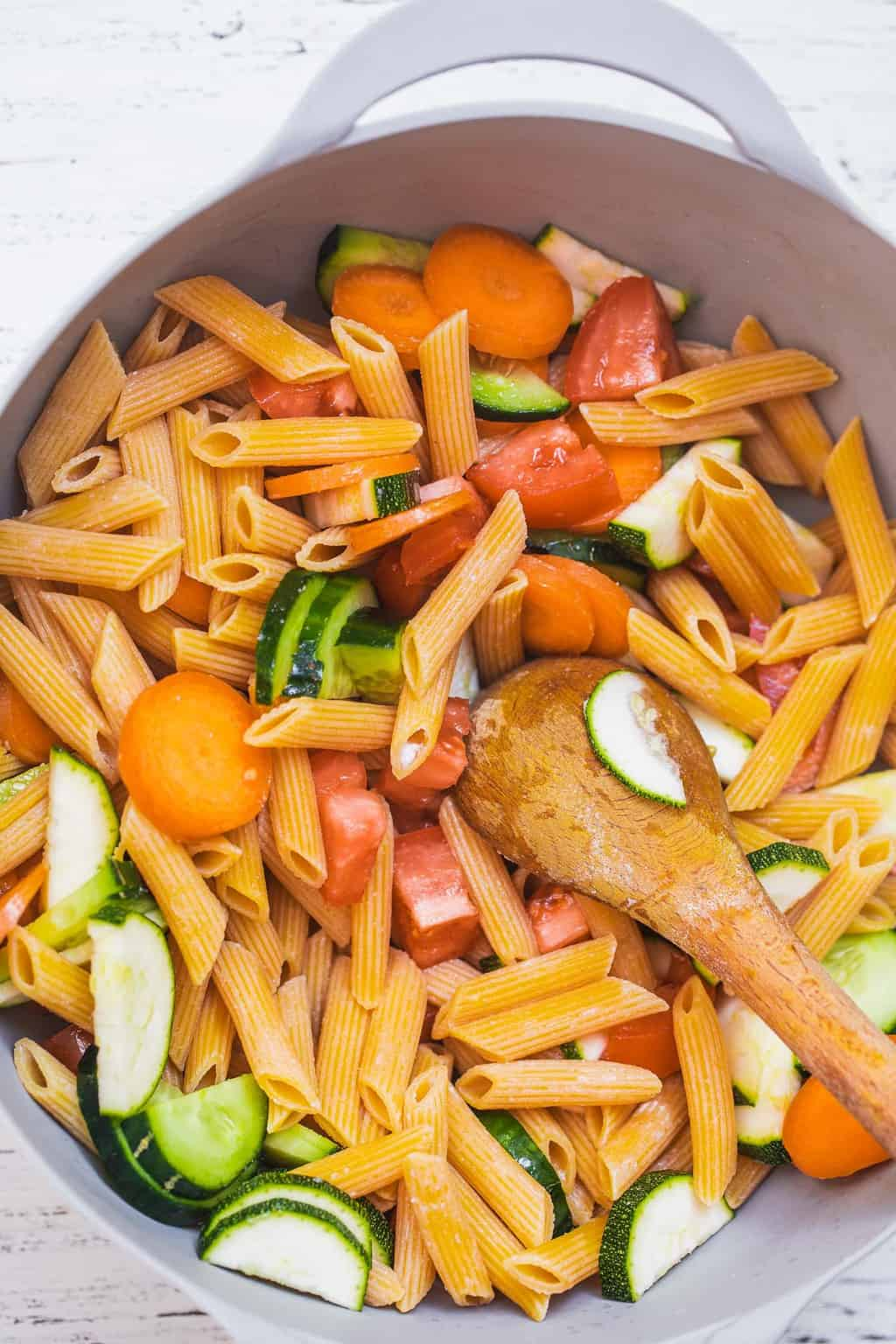 Pasta and vegetables in a mixing bowl