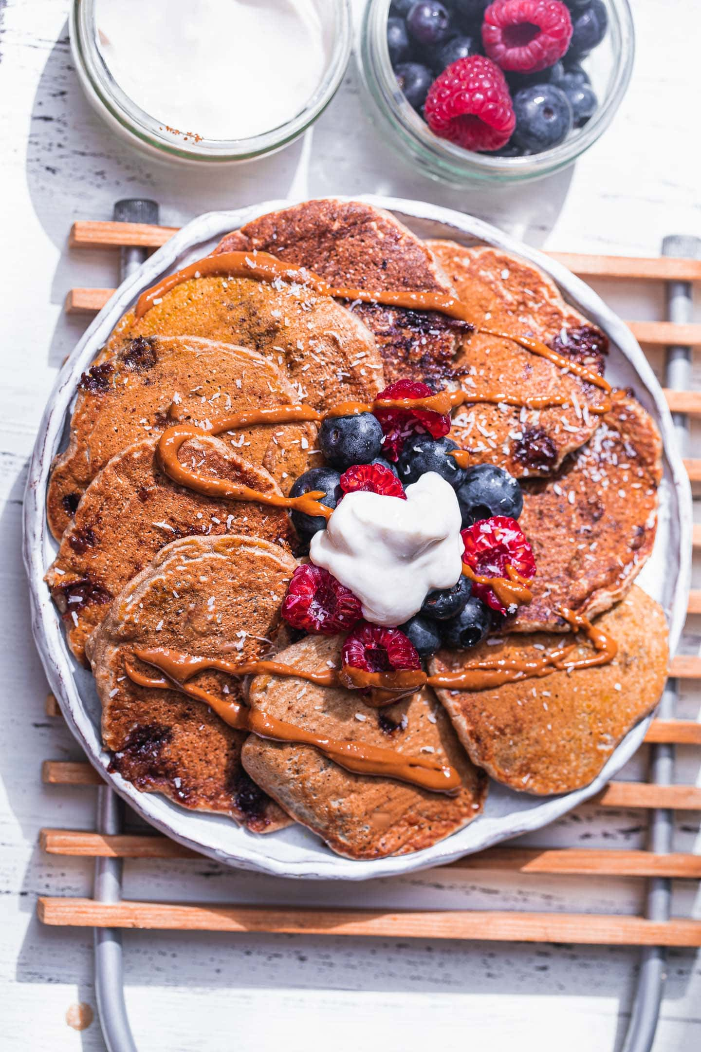 Vegan pancakes with chocolate chips and berries