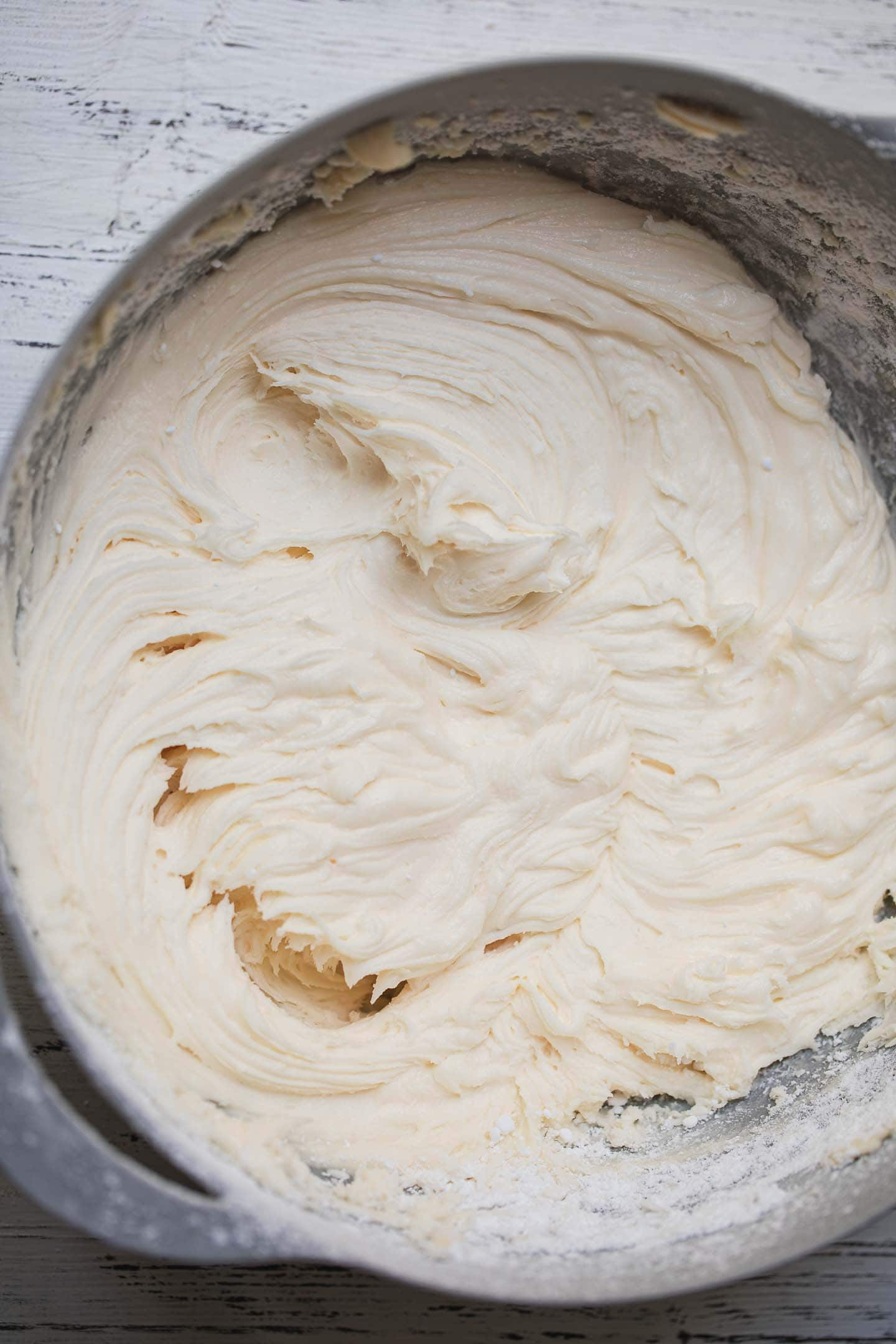 Vegan cream cheese icing in a mixing bowl