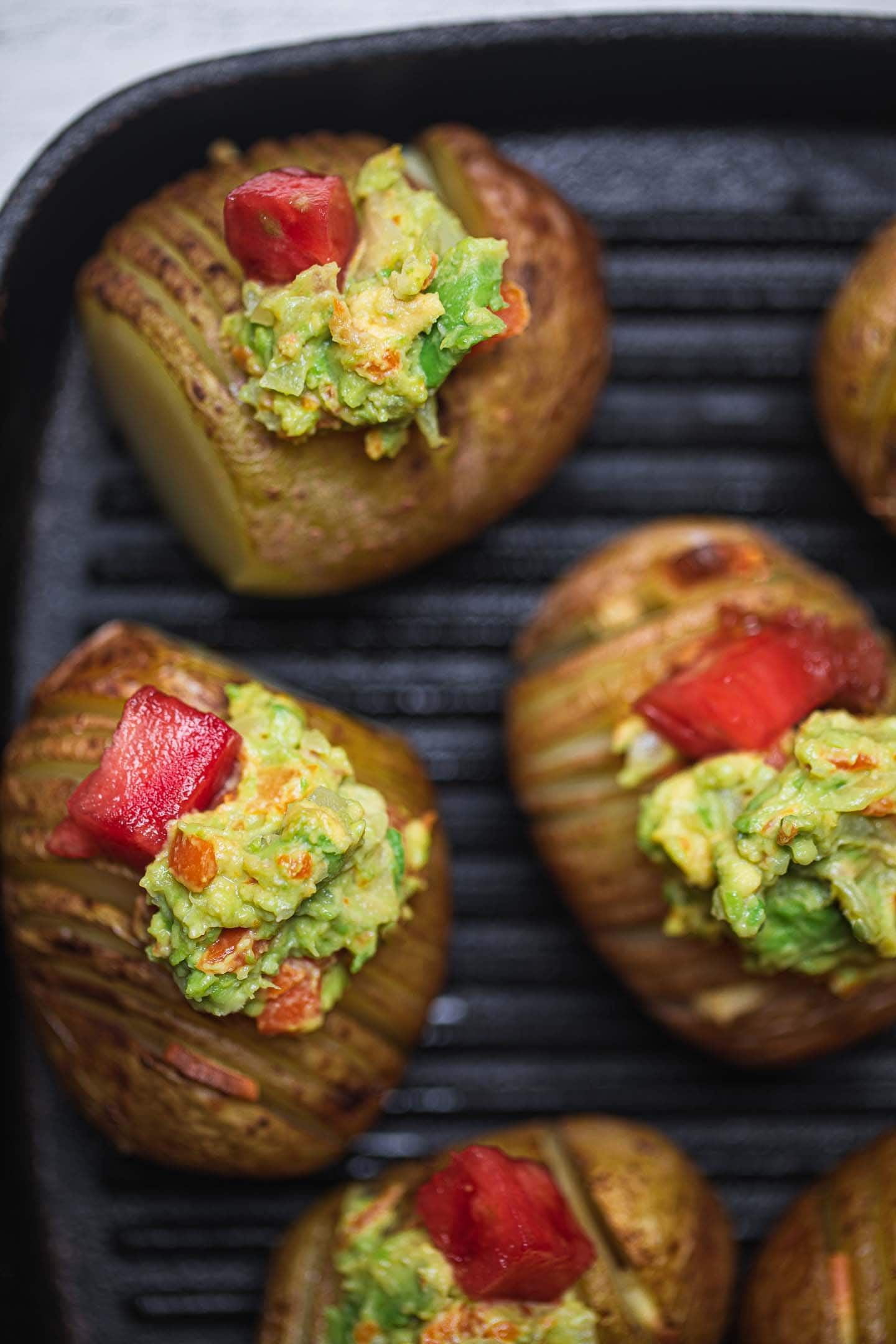 Closeup of potatoes with avocado and vegetables