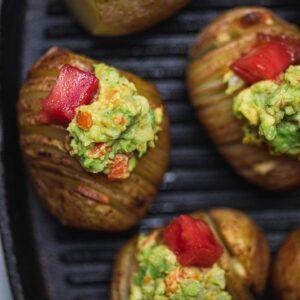 Vegan hasselback potatoes with avocado sauce