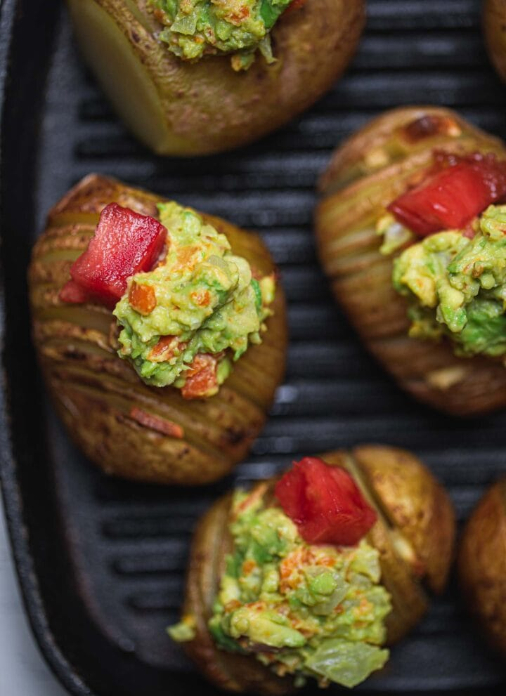 Vegan hasselback potatoes with avocado sauce