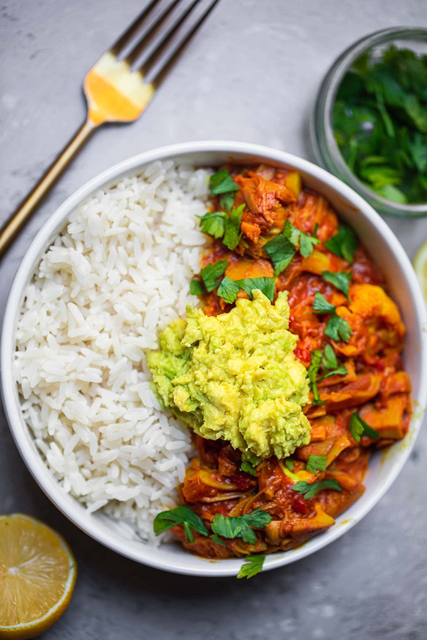 Jackfruit curry with avocado and rice in a bowl