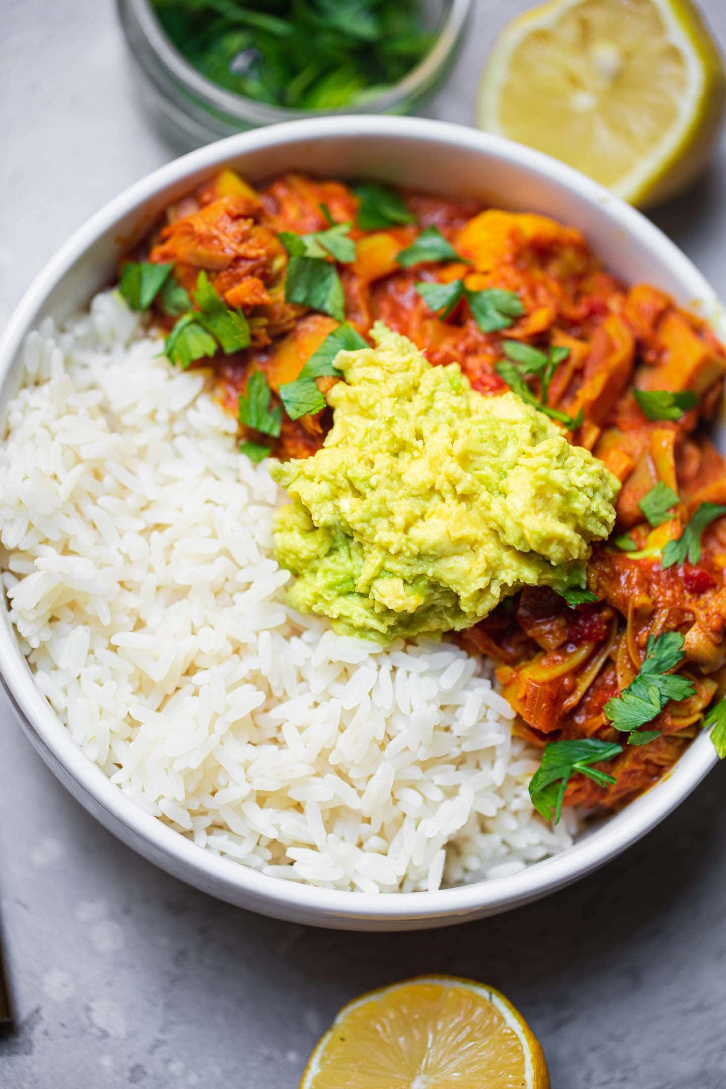 Bowl with jackfruit curry, avocado and rice