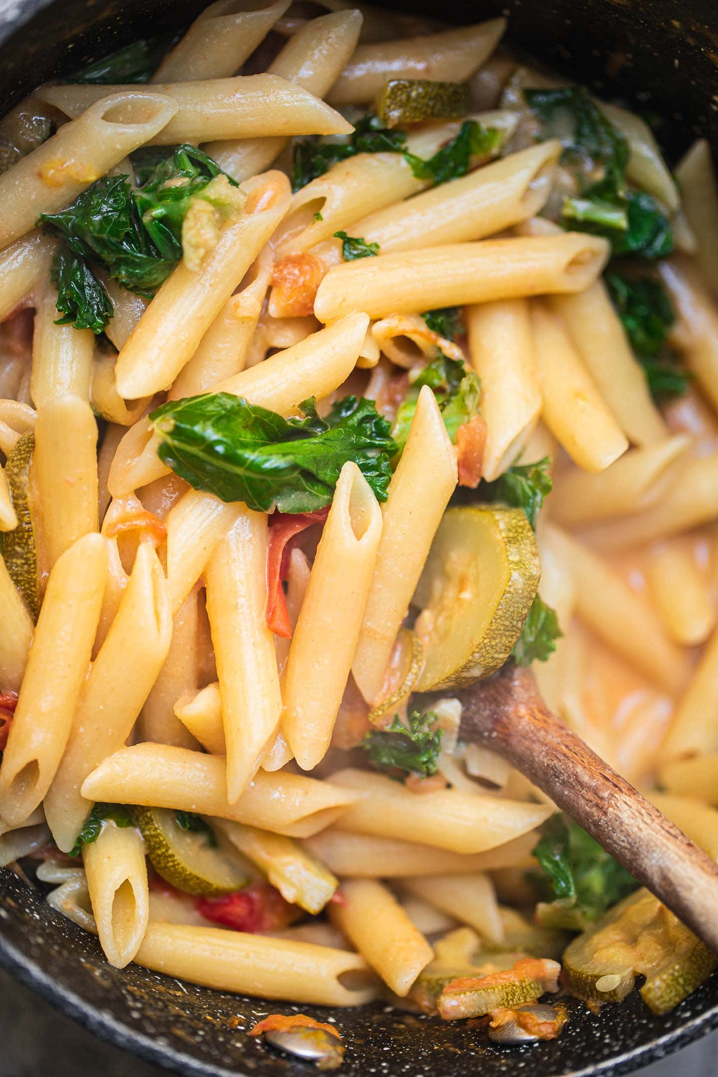 Vegan pasta dish with vegetables in a saucepan